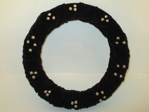 Black wreath with thumbtacks